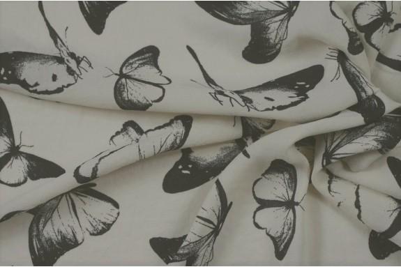 Crêpe stretch crème papillons noirs
